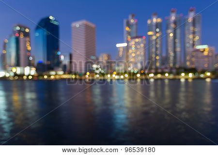 Abstract blurred bokeh of office building light at night