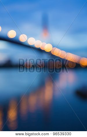 Abstract blurred bokeh light, the bridge waterfront at nigth