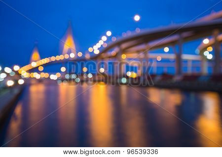 Abstract blurred bokeh light,highway intersection and the bridge waterfront at nigth