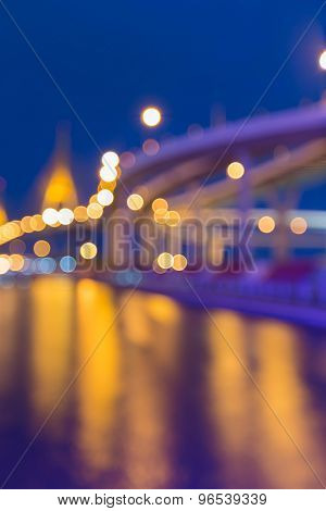 Abstract blurred bokeh light,highway intersection and the bridge waterfront