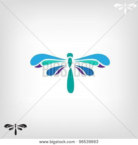 Dragonfly silhouette on light background.