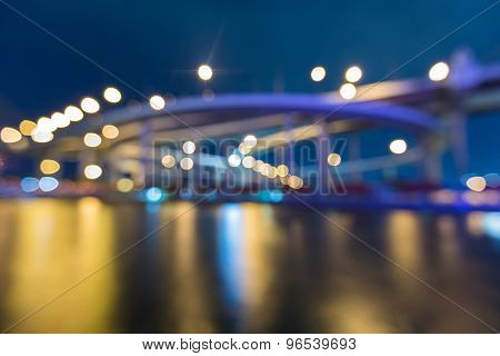 Bokeh light burred of Highway ring river front view