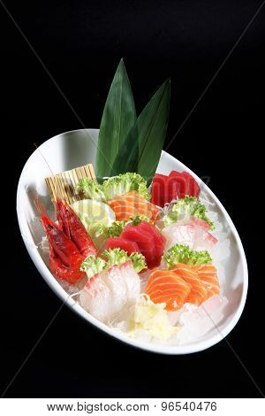 Round Plate Of Sashimi And Sushi