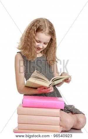 Blonde girl with a book in his hands