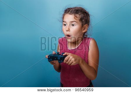 Girl European appearance decade holds a gaming joystick in his h