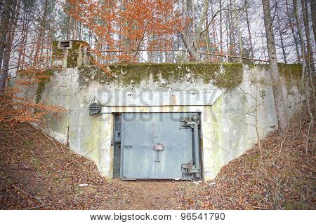 Old Abandoned Cold War Bunker In Forest.