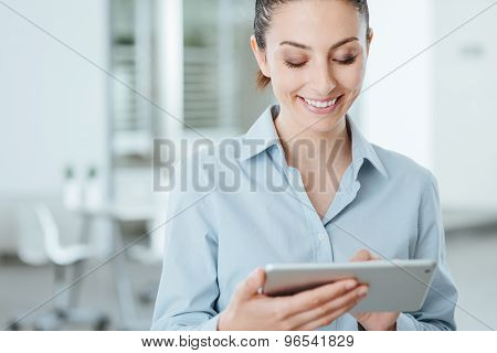 Young Business Woman Using A Digital Tablet