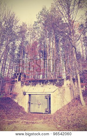 Vintage Instagram Filtered Picture Of A Bunker In Forest.