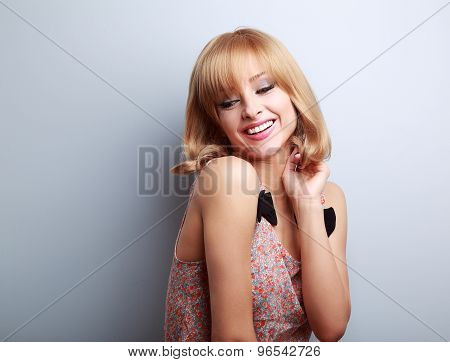 Relax Laughing Young Blond Woman With Short Hair Style Looking Down