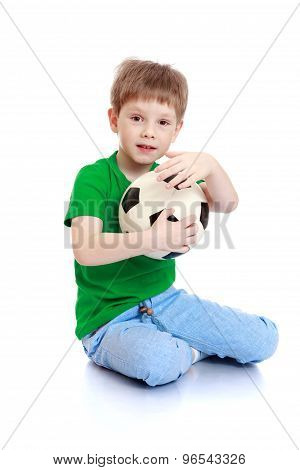 little boy with a soccer ball