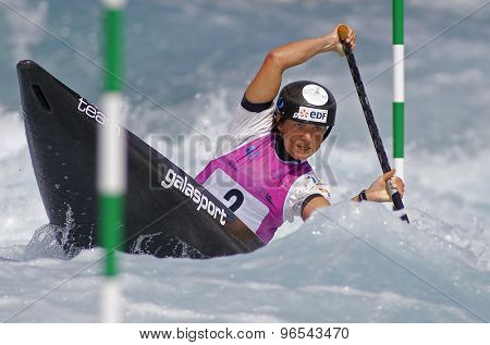 LONDON, ENGLAND - JUNE 06 2014 Caroline Loir of France competes at the ICF Canoe Slalom held at the Lea Valley White Water centre Waltham Abbey.