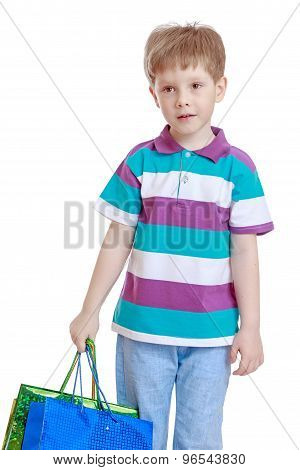 little boy with bags in their hands
