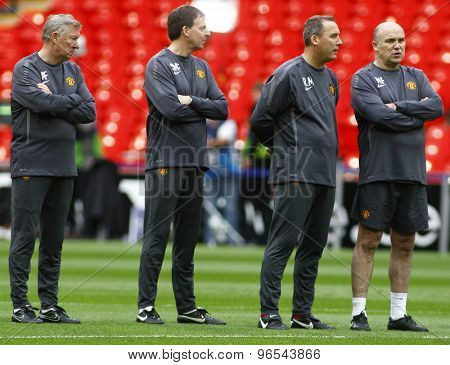 LONDON, ENGLAND. May 27 2011: Manchester's manager Sir Alex Ferguson and his coaching staff during the official training session for the 2011UEFA Champions League final