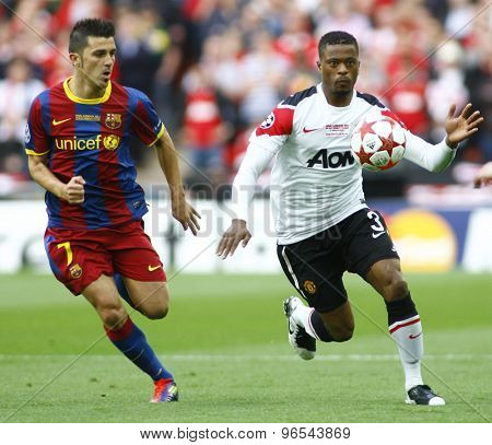 LONDON, ENGLAND. May 28 2011: Barcelona's midfielder Andreas Iniesta  and Manchester's defender Patrice Evra during the 2011UEFA Champions League final between Manchester United and FC Barcelona