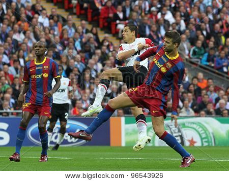 LONDON, ENGLAND. May 28 2011: Barcelona's Abidal. Manchester's Javier Hernandez and Barcelona's Gerard Pique during the 2011UEFA Champions League final between Manchester United and FC Barcelona