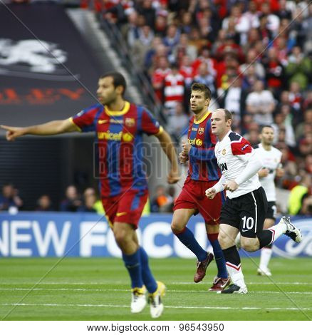 LONDON, ENGLAND. May 28 2011: Barcelona's defender Gerard Pique and Manchester's forward Wayne Rooney during the 2011UEFA Champions League final between Manchester United and FC Barcelona