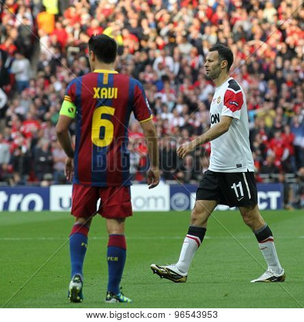 LONDON, ENGLAND. May 28 2011: Barcelona's midfielder Xavi Hernandez and Manchester's midfielder Ryan Giggs during the 2011UEFA Champions League final between Manchester United and FC Barcelona