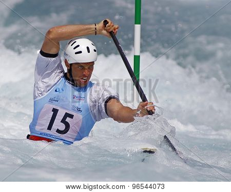 LONDON, ENGLAND - JUNE 06 2014 Matija Marinic of Croatia competes at the ICF Canoe Slalom held at the Lea Valley White Water centre Waltham Abbey.