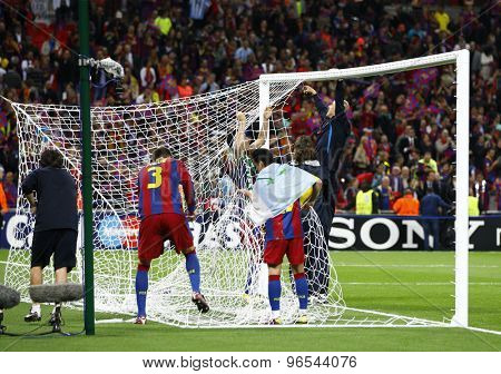 LONDON, ENGLAND. May 28 2011:  The Barcelona players strip the goal net for a keepsake after winning the 2011UEFA Champions League final between Manchester United and FC Barcelona, at Wembley Stadium