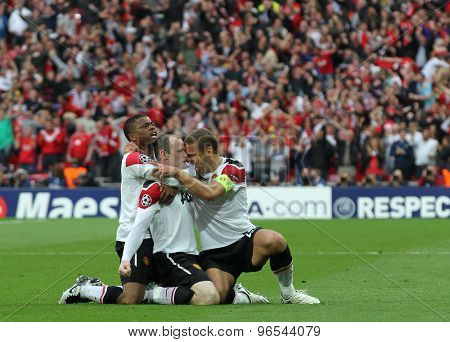 LONDON, ENGLAND. May 28 2011: Manchester's defender Patrice Evra Manchester's forward Wayne Rooney and Manchester's defender Nemanja Vidic (captain) during the 2011UEFA Champions League final