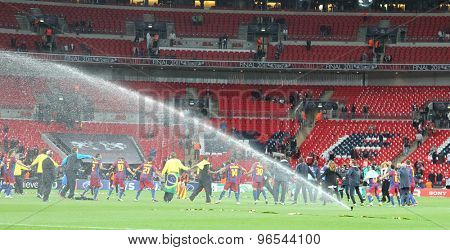LONDON, ENGLAND. May 28 2011: Barcelona dance in a ring the trophy for winning the 2011UEFA Champions League final between Manchester United and FC Barcelona, at Wembley Stadium