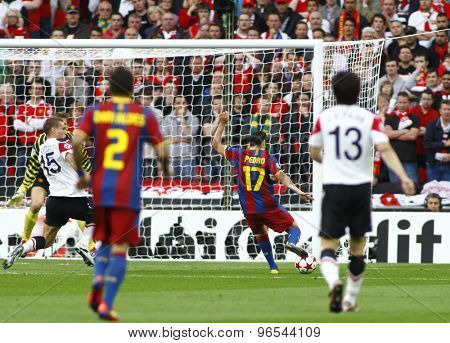 LONDON, ENGLAND. May 28 2011: Barcelona's midfielder Pedro Rodr�¢??guez takes a shot at goal during the 2011UEFA Champions League final between Manchester United and FC Barcelona, at Wembley Stadium