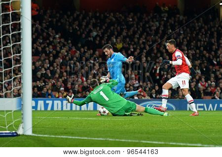 LONDON, ENGLAND - Nov 26 2013: Arsenal's Wojciech Szczesny makes a save from Marseille's Andre-Pierre Gignac during the UEFA Champions League match between Arsenal and Olympique de Marseille