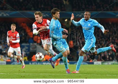 LONDON, ENGLAND - Nov 26 2013: Arsenal's Nacho Monreal runs with the ball during the UEFA Champions League match between Arsenal and Olympique de Marseille, at The Emirates Stadium