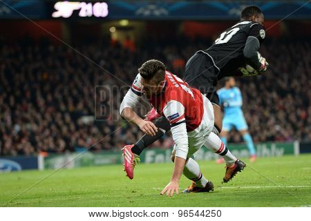 LONDON, ENGLAND - Nov 26 2013: Arsenal's Oliver Giroud and Marseille's Steve Mandanda  during the UEFA Champions League match between Arsenal and Olympique de Marseille, at The Emirates Stadium