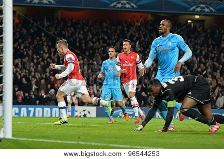 LONDON, ENGLAND - Nov 26 2013: Arsenal's Jack Wilshere celebrates scoring a goal during the UEFA Champions League match between Arsenal and Olympique de Marseille, at The Emirates Stadium
