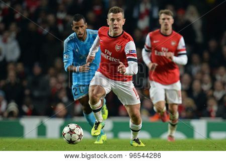 LONDON, ENGLAND - Nov 26 2013: Arsenal's Jack Wilshere runs with the ball during the UEFA Champions League match between Arsenal and Olympique de Marseille, at The Emirates Stadium