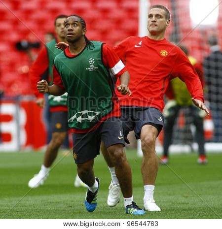 LONDON, ENGLAND. May 27 2011: Manchester's midfielder Anderson and defender Nemanja Vidic (captain) during the official training session for the 2011UEFA Champions League final