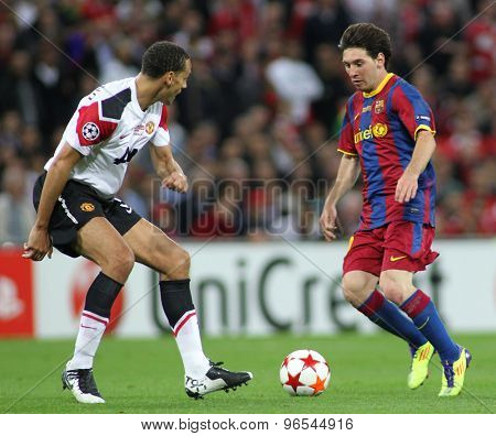 LONDON, ENGLAND. May 28 2011: Manchester's defender Rio Ferdinand and Barcelona's forward Lionel Messi during the 2011 UEFA Champions League final between Manchester United and FC Barcelona