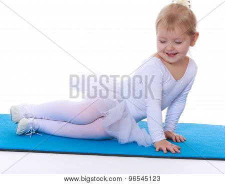 Cute little gymnast on the Mat