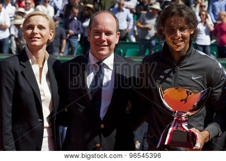 MONTE CARLO, MONACO. APRIL 22 2012 Princess Charlene, and Albert II, Sovereign Prince of Monaco present Rafael Nadal (ESP) with his trophy for winning the final singles  at the ATP Monte Carlo Masters