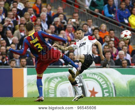 LONDON, ENGLAND. May 28 2011: Barcelona's defender Gerard Pique and Manchester's midfielder Ryan Giggs during the 2011UEFA Champions League final between Manchester United and FC Barcelona