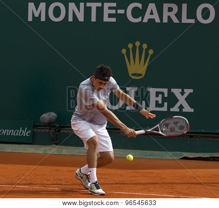 MONTE CARLO, MONACO. APRIL 18 2012 Bernard Tomic (AUS)  in action during the second round match between Bernard Tomic (AUS) and Alexandr Dolgopolov (UKR)  at the ATP Monte Carlo Masters  .