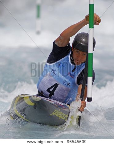 LONDON, ENGLAND - JUNE 06 2014 Anze Bercic of Slovenia competes at the ICF Canoe Slalom held at the Lea Valley White Water centre Waltham Abbey.