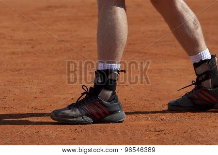 MONTE CARLO, MONACO. APRIL 19 2012  Andy Murray (GBR) and his ankle supports during the second round match between Andy Murray (GBR) and Julien Benneteau (FRA) at the ATP Monte Carlo Masters  .