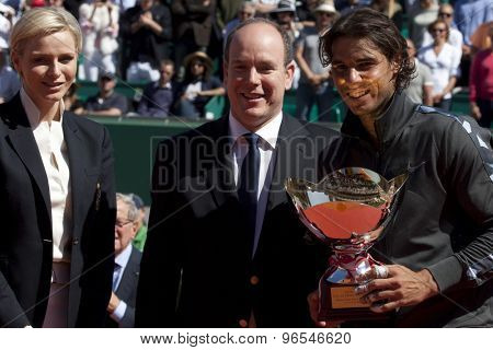 MONTE CARLO, MONACO. APRIL 22 2012 Princess Charlene, and Albert II Sovereign Prince of Monaco present, Rafael Nadal (ESP) with his trophy for winning the final singles  at the ATP Monte Carlo Masters