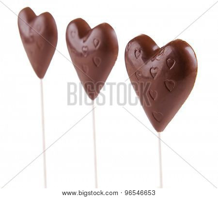Chocolate candies in shape of hearts isolated on white