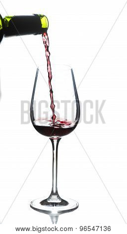 Glass Of Red Wine While Pouring Wine