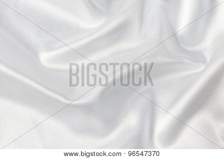 White background of delicate silk with pleats.