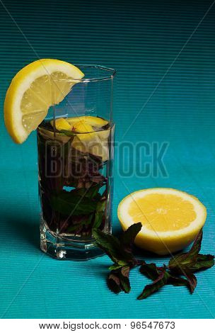 Mojito Cocktail With Lemon And Mint On Blue Background
