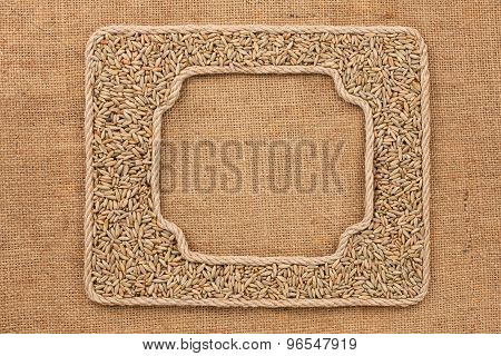 Two Frames Made Of Rope With Rye  Grains On Sackcloth