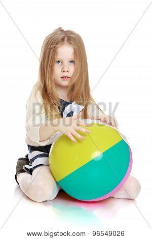 Girl holding hands the ball