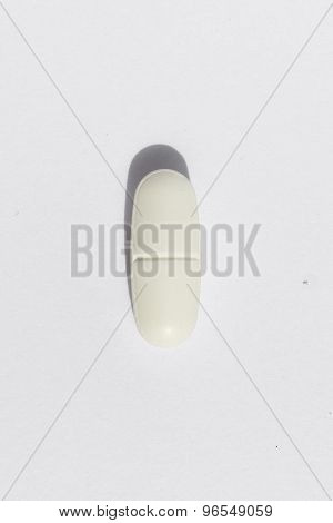 single white pill macro isolated on white