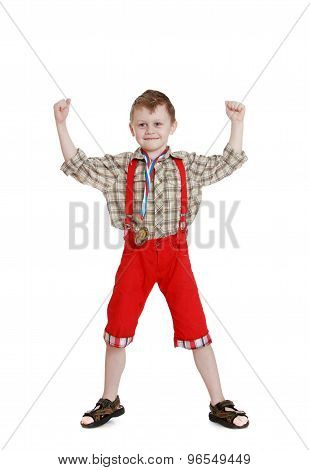 boy in a long red shorts