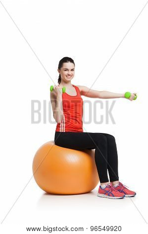 Beautiful sport woman doing  fitness exercise on ball