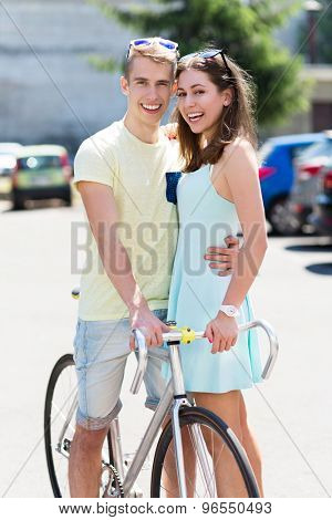 Young couple with bike